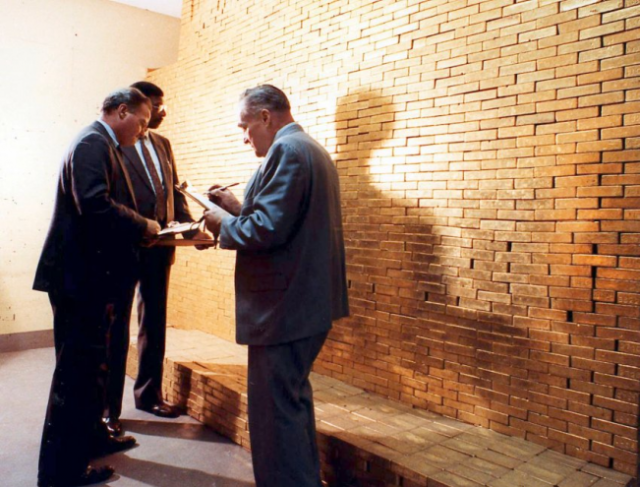 FRBNY-Men-Inspecting-Wall-of-Gold-651x495